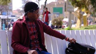 Black Young Waiting at Park