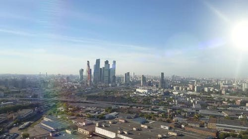 Moscow City Skyscrapers Through Sun Rays. Business Center of Moscow. Towers and Houses of the