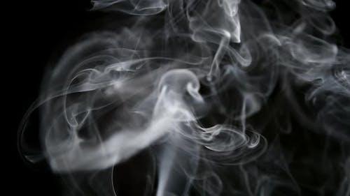 Tabacco smoke on a black background