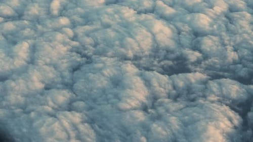 Airplane Flight Over Cloudscape