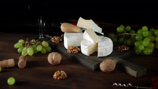 Thumbnail for Camembert Cheese with Nuts and Grapes Slowly Rotate.