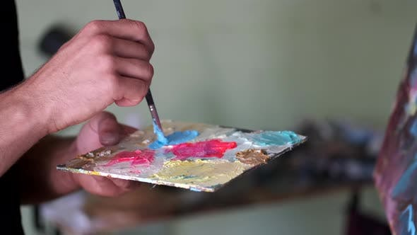 Thumbnail for Artist Getting Ready To Paint By Mixing and Blending Paint