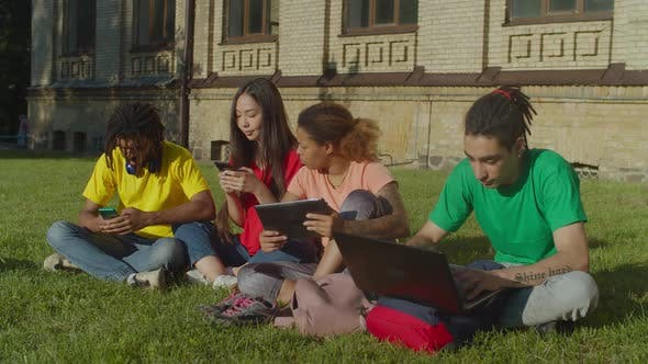 Thumbnail for Multiethnic Students Studying with Digital Devices