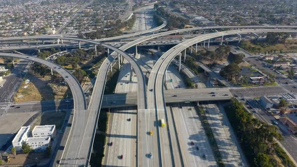 Thumbnail for Topdown View Over a Roadbed of Los Angeles Freeway Filled with Moving Cars