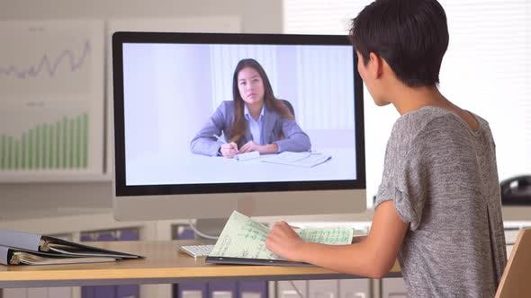 Thumbnail for Chinese women having a remote meeting online