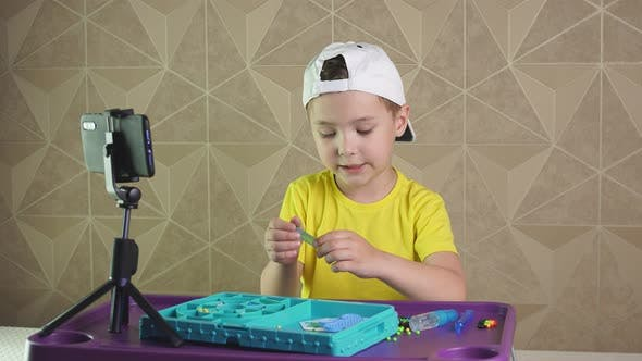 Distance Learning. A Pre-school Boy Records Videos for Children. Online Lessons