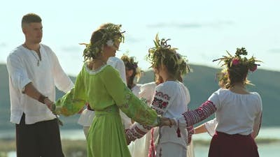 Slavic People Lead a Round Dance in Folk Costumes