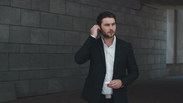 Thumbnail for Male Employee Using Bluetooth Earbuds Outside. Business Man Waiting Client