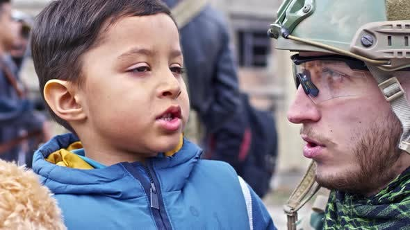 Thumbnail for Soldier Talking to Refugee Boy