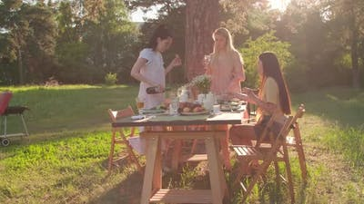 Three Women Having Dinner