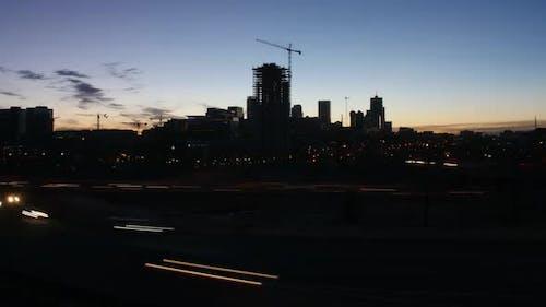 Denver Skyline with Interstate Traffic Timelapse