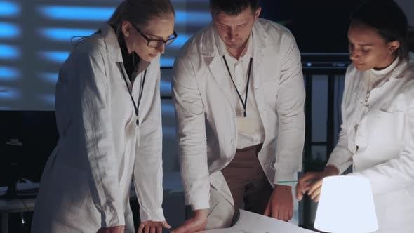Thumbnail for Close Up of Mixed Race Engineers Working on the Project in Lab