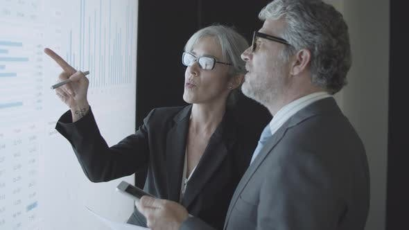 Thumbnail for Female Finance Professional Giving Consultation To Male Client