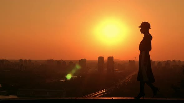 Woman Engineer Outdoors Cityscape at Sunrise