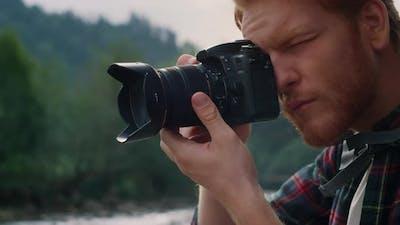 Man Taking Photos on Photo Camera