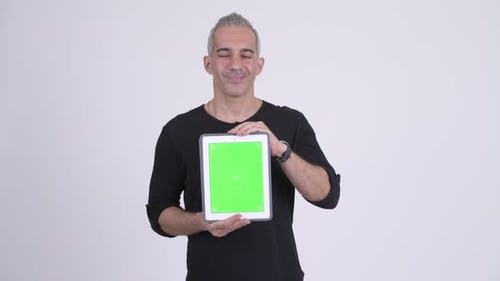 Happy Handsome Persian Man Showing Digital Tablet