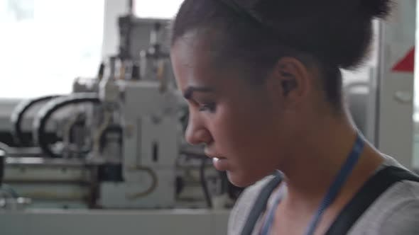 Thumbnail for Hardworking Female Factory Laborer Working
