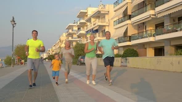 Family evening jog on vacation
