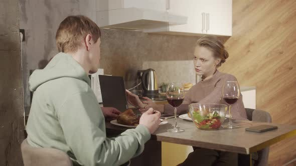 Young Emancipated Businesswoman Does Not Pay Attention To Her Husband Who Prepared Festive Dinner