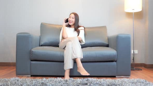 Young asian woman use smart phone