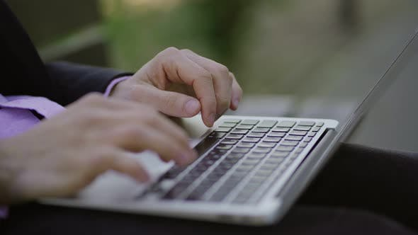Thumbnail for Male Hands Typing on Keyboard of Laptop