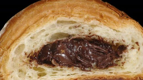 Soft Fresh Croissant With Chocolate Filling In The Cut