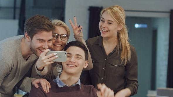 Thumbnail for Smiling business people taking selfie in meeting room at
