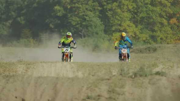 Cover Image for Riders on motocrosses doing stunts