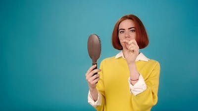 Model Poses with Hairbrush in Studio