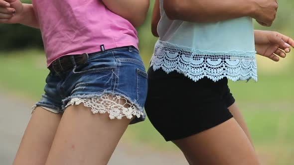 Cover Image for Two Young Ladies in Short Shorts Making Dances Moves With Their Hips Touching