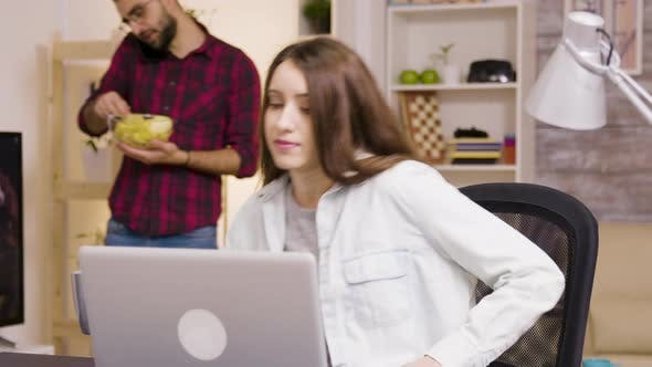 Thumbnail for Girl Enjoying a Cup of Coffee While Working on Laptop in Living Room