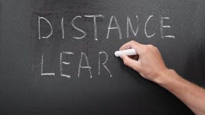 Distance learning written on chalkboard
