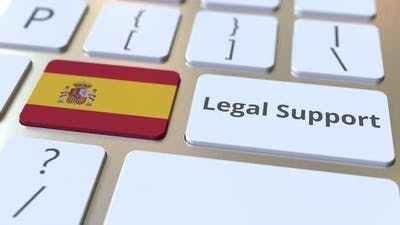 Legal Support Text and Flag of Spain on the Computer Keyboard