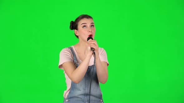 Thumbnail for Pretty Girl Sings Into a Microphone and Moves To the Beat of Music