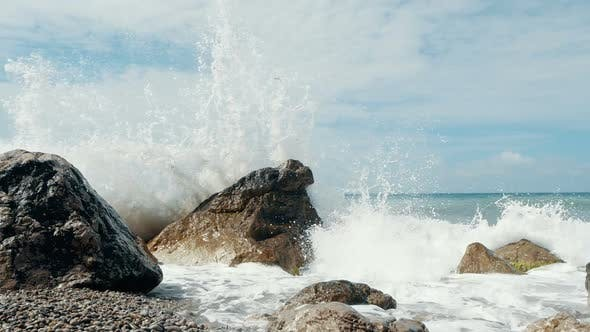 Thumbnail for Big Wave Crashing on Stones and Spraying. Sudden Splash of Water. Waves Breaking on Stones