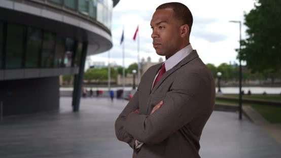 Accomplished black corporate executive posing with determination in London