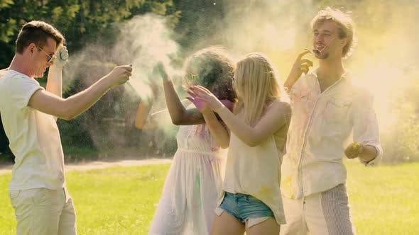 Cover Image for Romantic Couples Throwing Colored Powder Paint at Each Other Extra Slow Motion