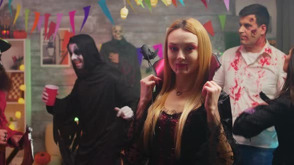 Sexy Blonde in Enchantress Costume at Halloween Party