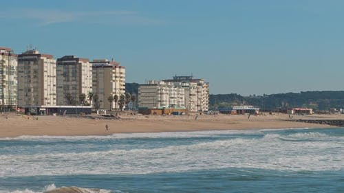 View of the Seixal Beach in Portugal, Lisbon, on a sunny winter day.