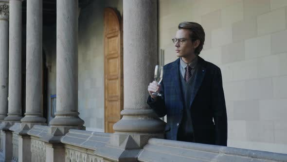 Thumbnail for Student Drinking Champagne in Hallway .Businessman Drinking Champagne Outdoors