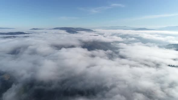 Thumbnail for Dramatic Weather in the Mountains After Rain, Fog in the Mountains, Aerial View