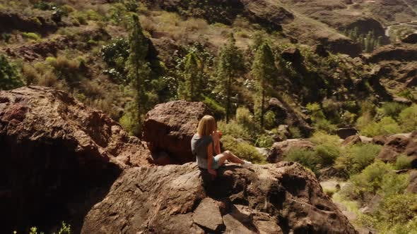Thumbnail for Beautiful Woman Sitting on the Big Rock