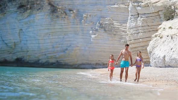 Cover Image for Happy Beautiful Family of Dad and Kids on White Beach