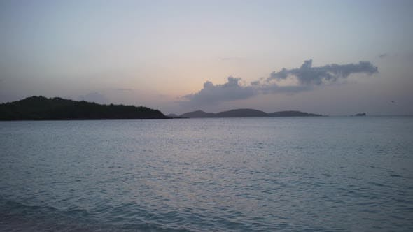 Thumbnail for Background plate of sun setting over islands in the distance in the Caribbean