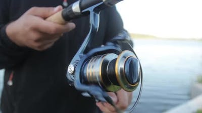 Close-up of Fishing Line Reel During Fishing