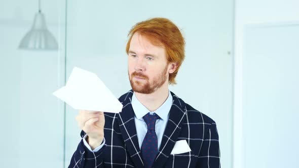 Thumbnail for Creative Businessman Holding Paper Plane in Hand, Time to Fly