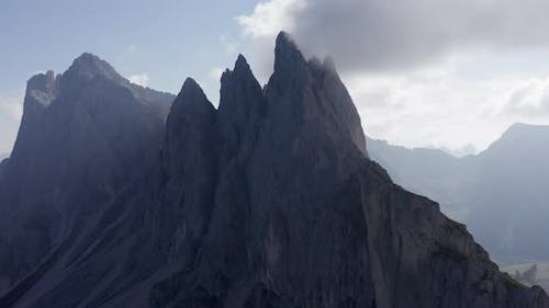 Aerial Shot of Italian Mountain Seceda with Fog Surrounding It