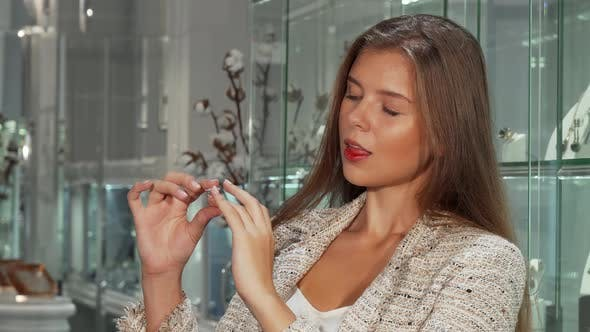 Thumbnail for Gorgeous Woman Trying on Expensive Rings at the Jewelry Store