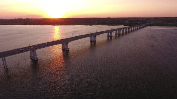 Cover Image for Aerial Shot of an Outstretched Bridge Over the Dnipro at a Nice Sunset in Summer