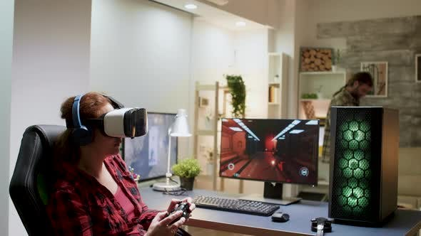 Side View of Woman with Red Hair Wearing Vr Goggles